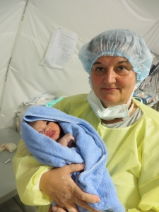 "Monica, the outspoken midwife, with ""my"" first child"