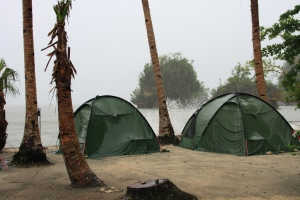 Our tents on the beach, battered by the rain and the waves